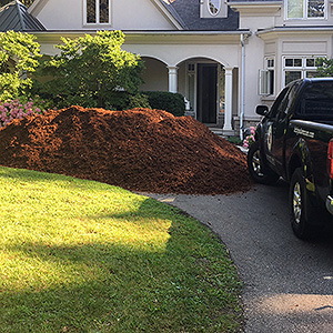 Kick Gas Lawn Care provides landscaping services like mulch and soil installations throughout Mississauga.